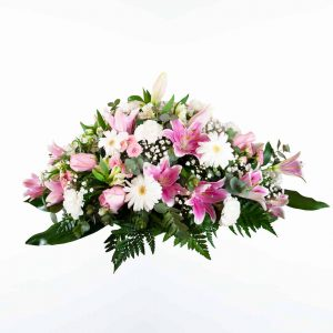 Centro de flores rosa para funeral en tonos rojos y blancos a domicilio en Madrid y Toledo