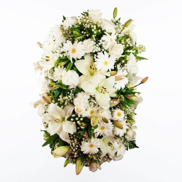 Palma de flores blanca para funerales morada, verde y rosa para enviar a tanatorios de madrid y toledo con cinta de condolencias.