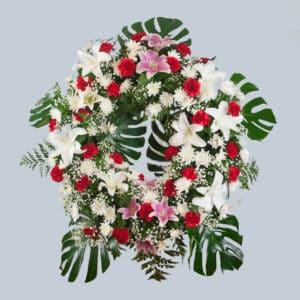 Enviar una corona de flores roja y blanca al tanatorio.